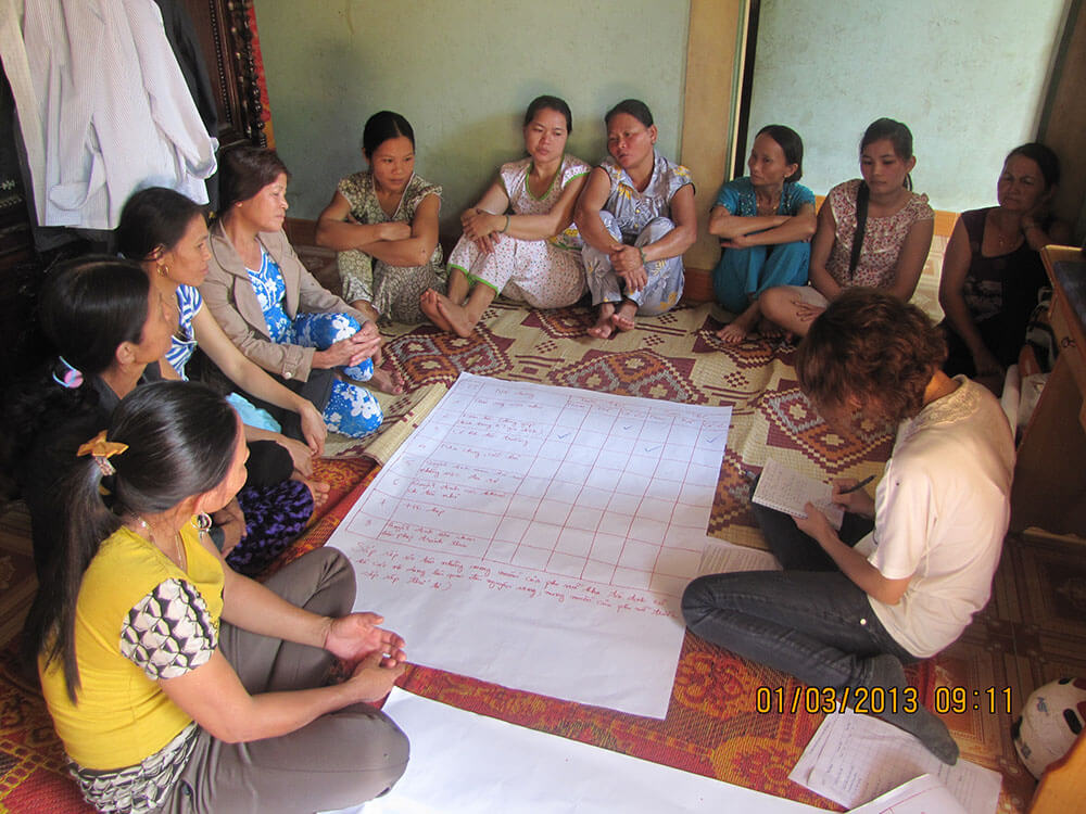 Women from Ben Van village, Loc Bon Commune, discuss the issues they face since being moved from their original homes.